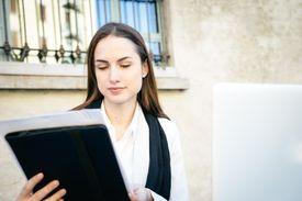 Woman reviewing grad school letter