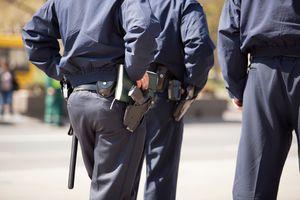 Armed police officers walking away