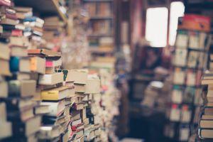 Room full of stacks of books.