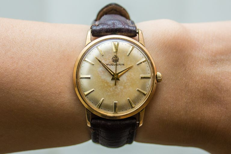 A wristwatch worn by a person