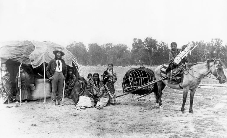 Southern Cheyenne Stump Horn and his family outside home in 1890.