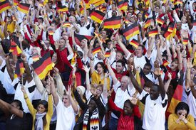 German crowd cheering and waving flags
