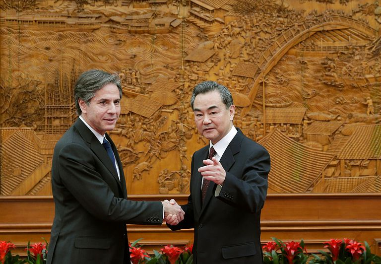 Then Deputy Secretary of State Antony Blinken shakes hand with Chinese Foreign Minister Wang Yi at the Olive Hall before a meeting at the Foreign Ministry office on February 11, 2015 in Beijing.