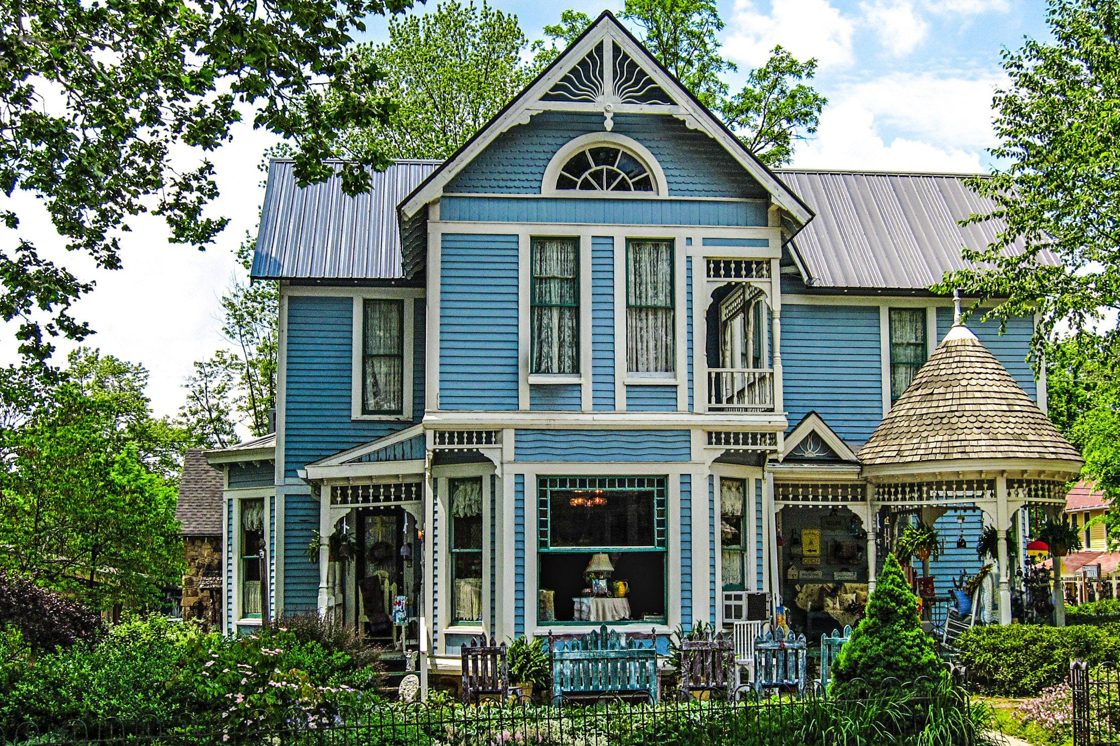 Ornate Victorian Style House Painted Bird S Egg Blue With White Trim And Dark Metal Roof
