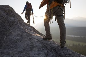 Climbers ascend mountain ridge