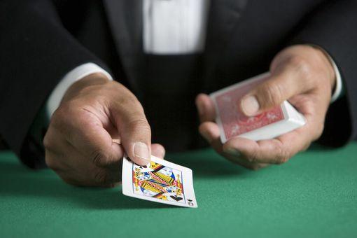 Man dealing deck of cards, close-up