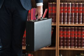 A man holds a briefcase