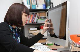 Web designer working in her studio.