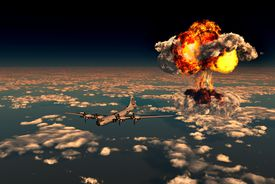 B-29 Superfortress flying away from the explosion of the atomic bomb.