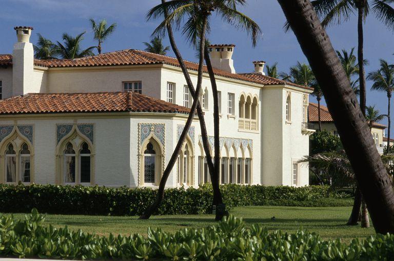 Spanish Style Architecture In Florida House Of White Masonry Siding Red Tile Roof Gaudi Like Chimney Pots