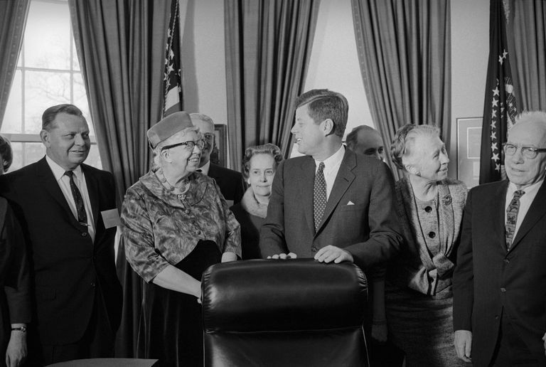 John Kennedy with members of the President's Commission on the Status of Women