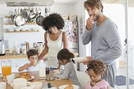 Mixed race family at the breakfast table.