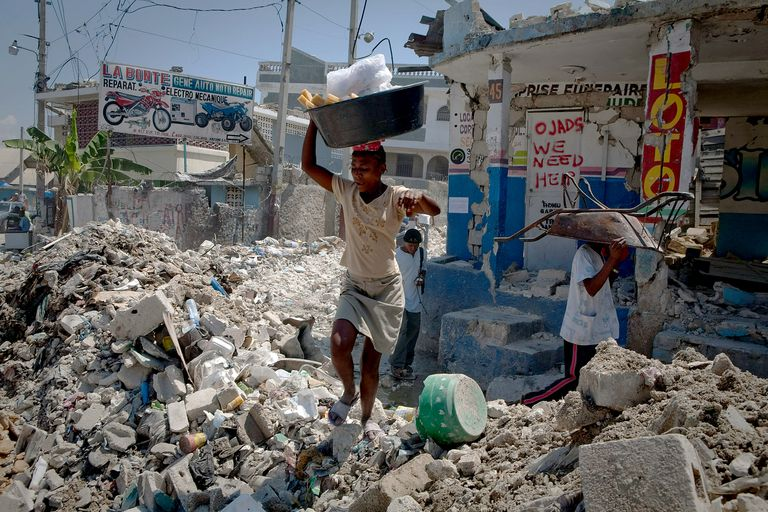 Residents make their way through debris in Port-au-Prince, Haiti