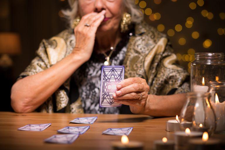 Fortune teller reading tarot card