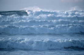 Large ocean swell caused by warming of surface waters in the southeastern Pacific creating the phenomenon known as El Nino, cause of severe winter weather in California, USA