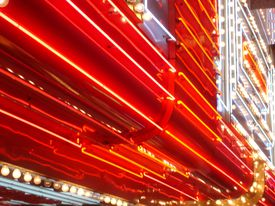 The normal color of excited neon gas is reddish-orange.
