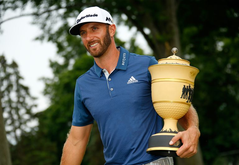 Dustin Johnson with the trophy after winning the 2016 WGC Bridgestone Invitational.