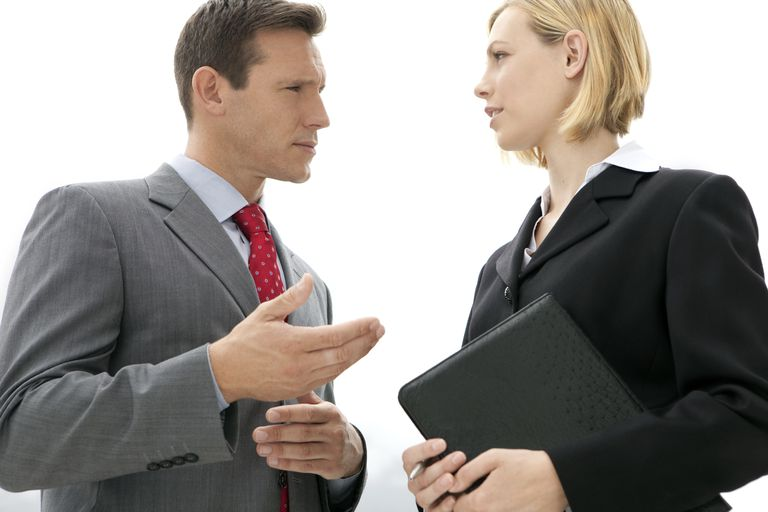 Man and woman facing each other who look like they in a tense conversation.