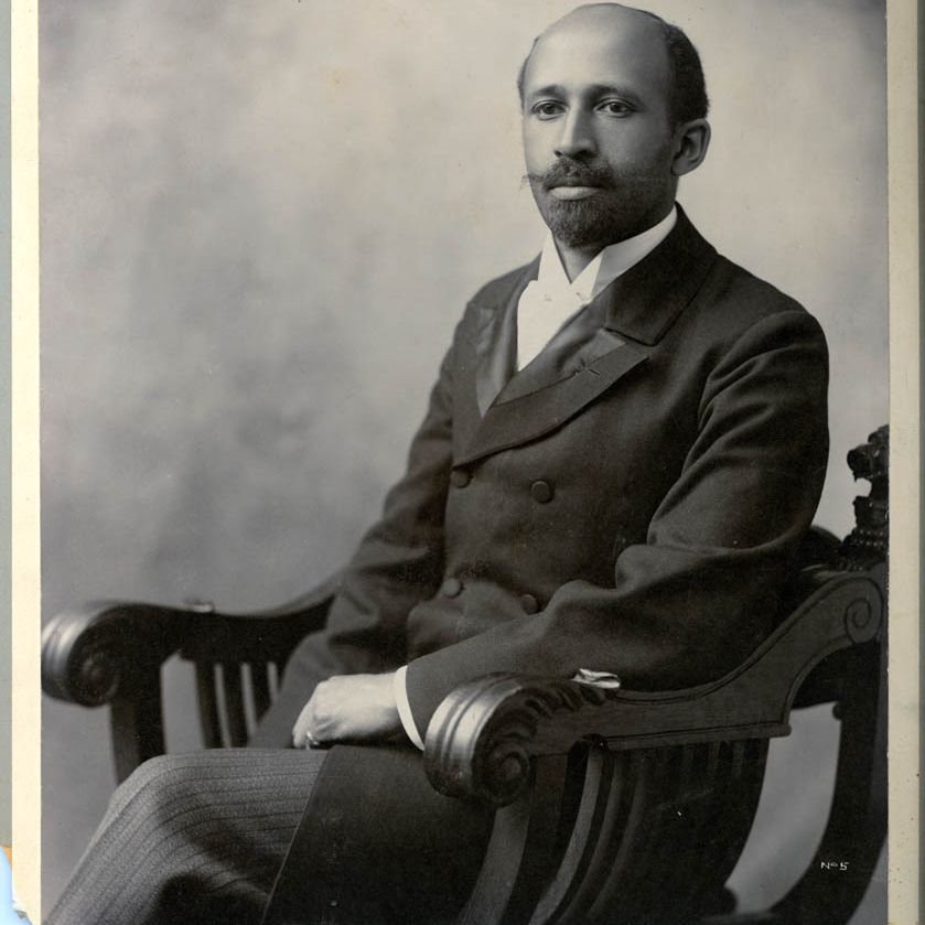 Sociologist and activist W.E.B. Du Bois sitting in a chair