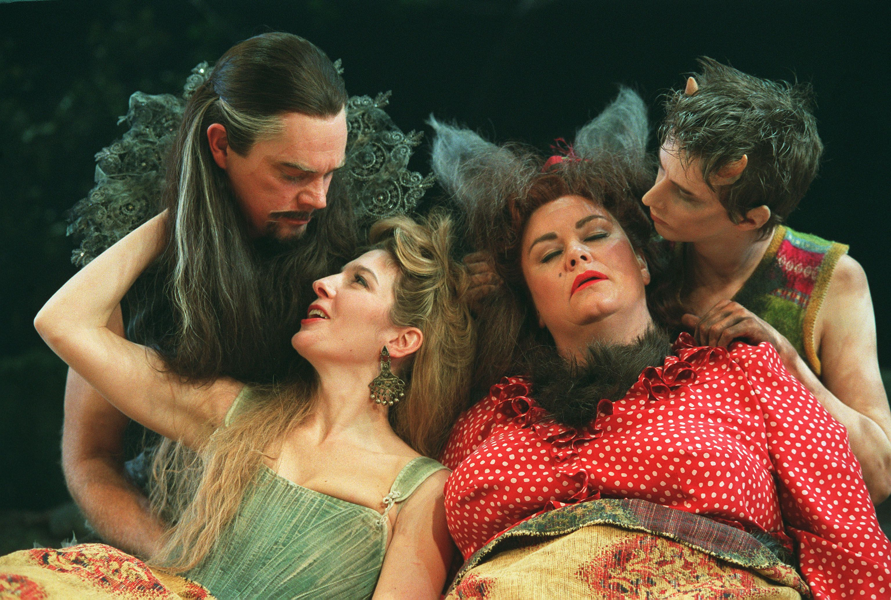 The fairies Oberon, Titania, and Puck onstage with Bottom, who has donkey ears