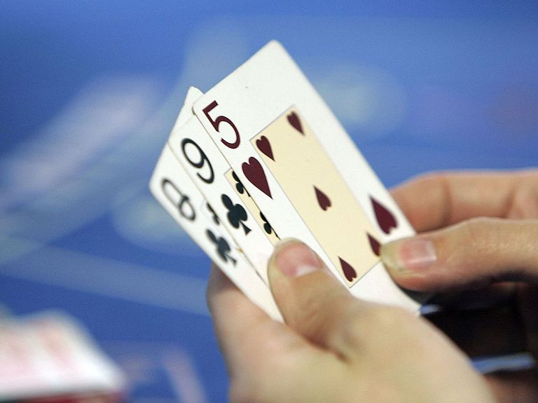 close up of a hand of cards