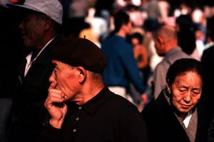 A doubtful man is uncertain whether or not to buy something at Kyoto market, southern Honshu
