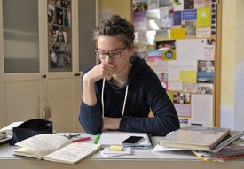Portrait of female pupil at her desk