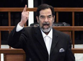 Former Iraqi President Saddam Hussein shouts as he receives his guilty verdict during his trial on November 5, 2006 in Baghdad, Iraq.