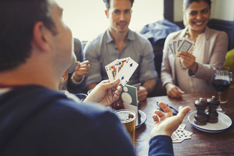 Friends playing poker and drinking
