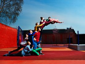 A group of gymnasts cooperating