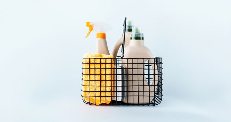 Сlose-up of bottles of cleaning products and a microfiber cloth