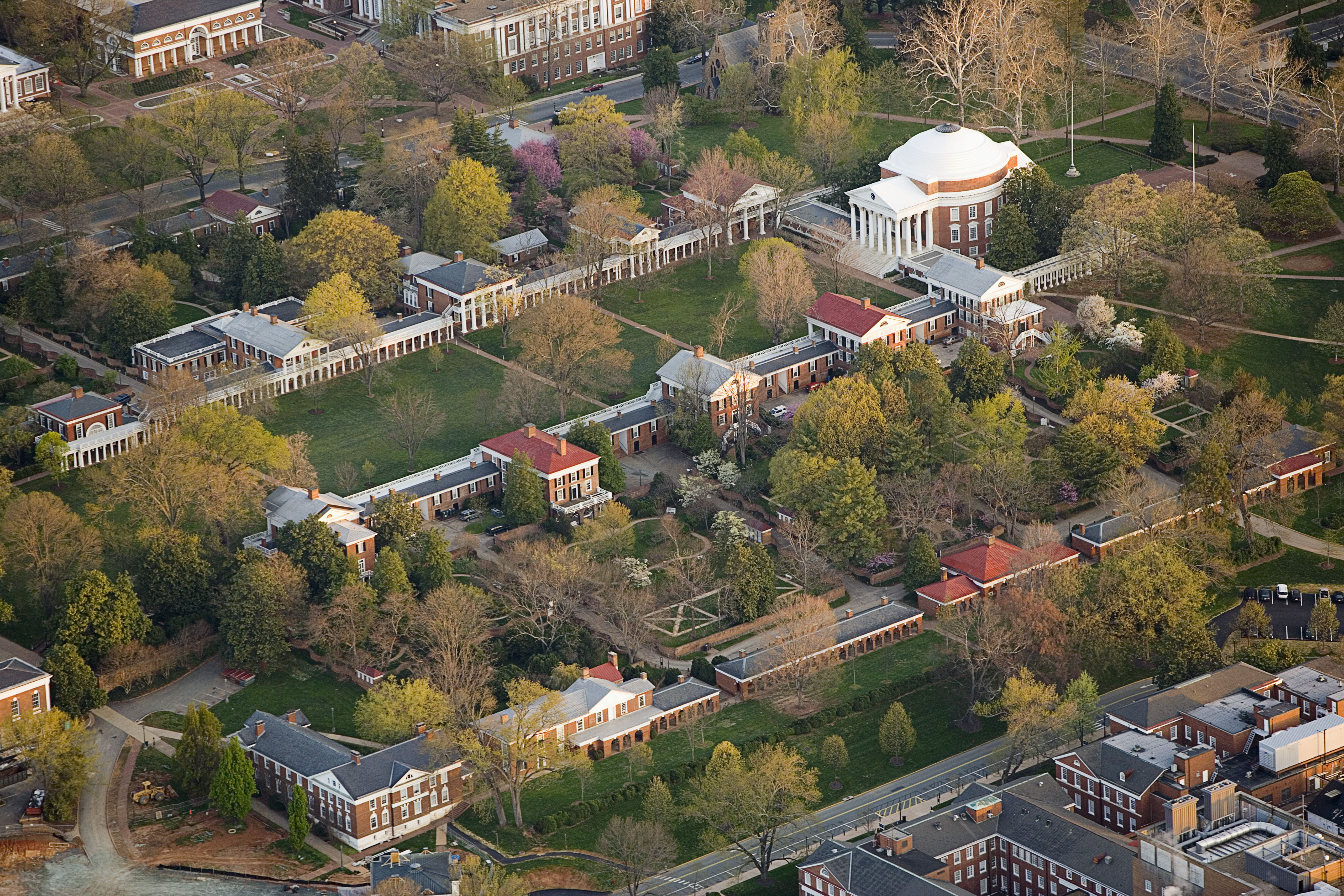 aerial view of landscaped campus headed by a white domed building