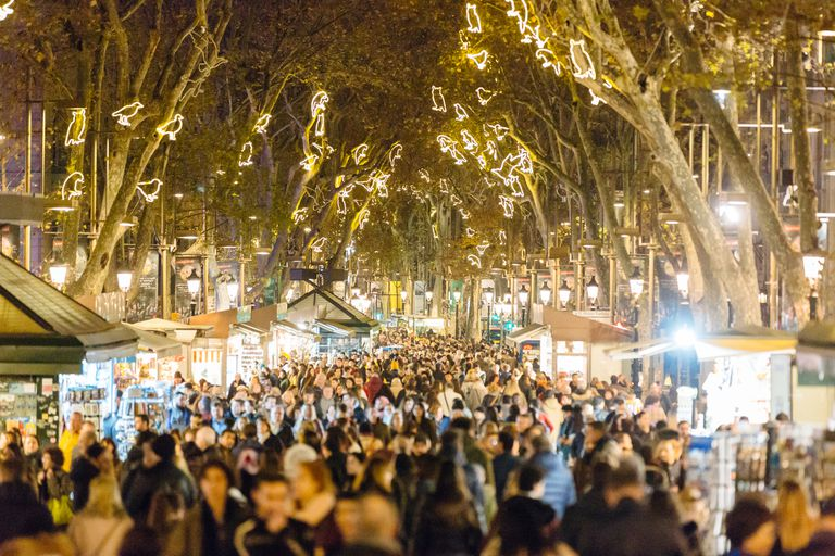 People walking at La Rambla street during Christmas and New Year holidays in Barcelona, Catalonia, Spain