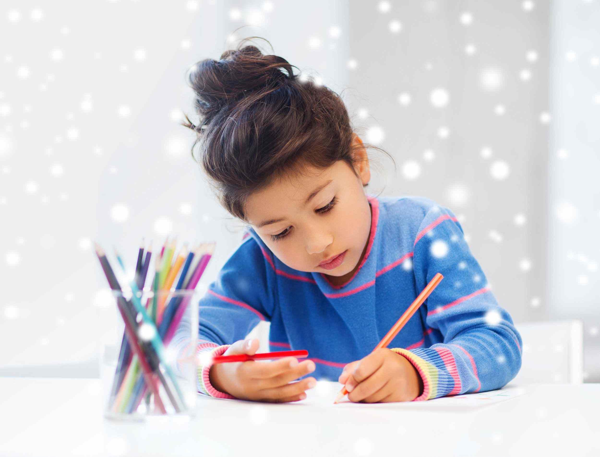 Girl doing homework with colored pencils