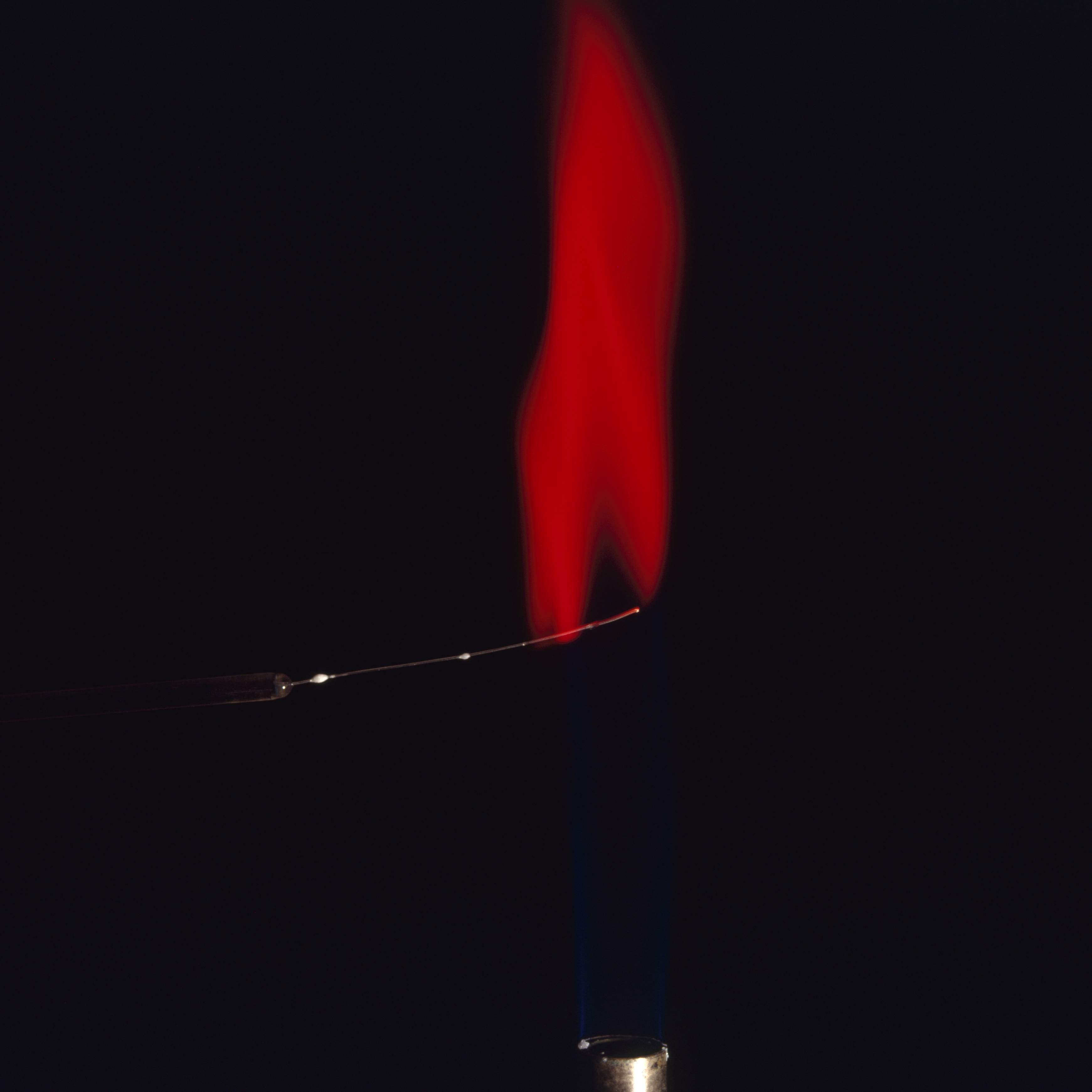Strontium compounds turn a flame red