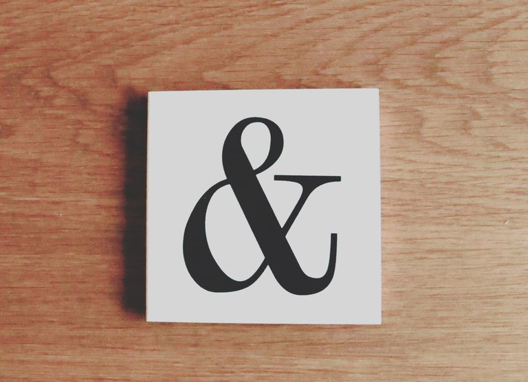 Close-Up Of Ampersand Symbol On Table