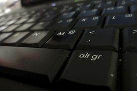 The Alt key on a black keyboard is required for Spanish accents and punctuation