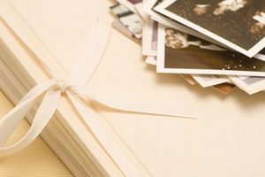 Scrapbooking with old photographs. Photo: Getty Images/Photodisc/Walter B. McKenzie