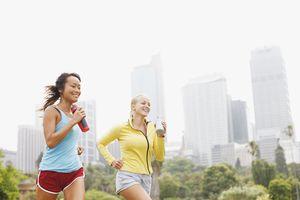 Friends running in urban park