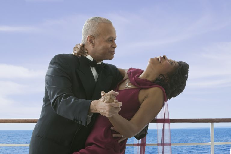 Formal couple dancing on cruise ship