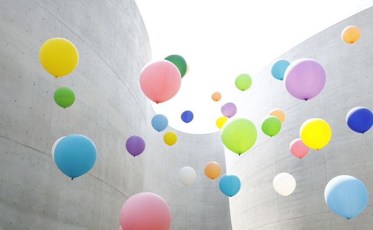 Balloons floating through curved walls.