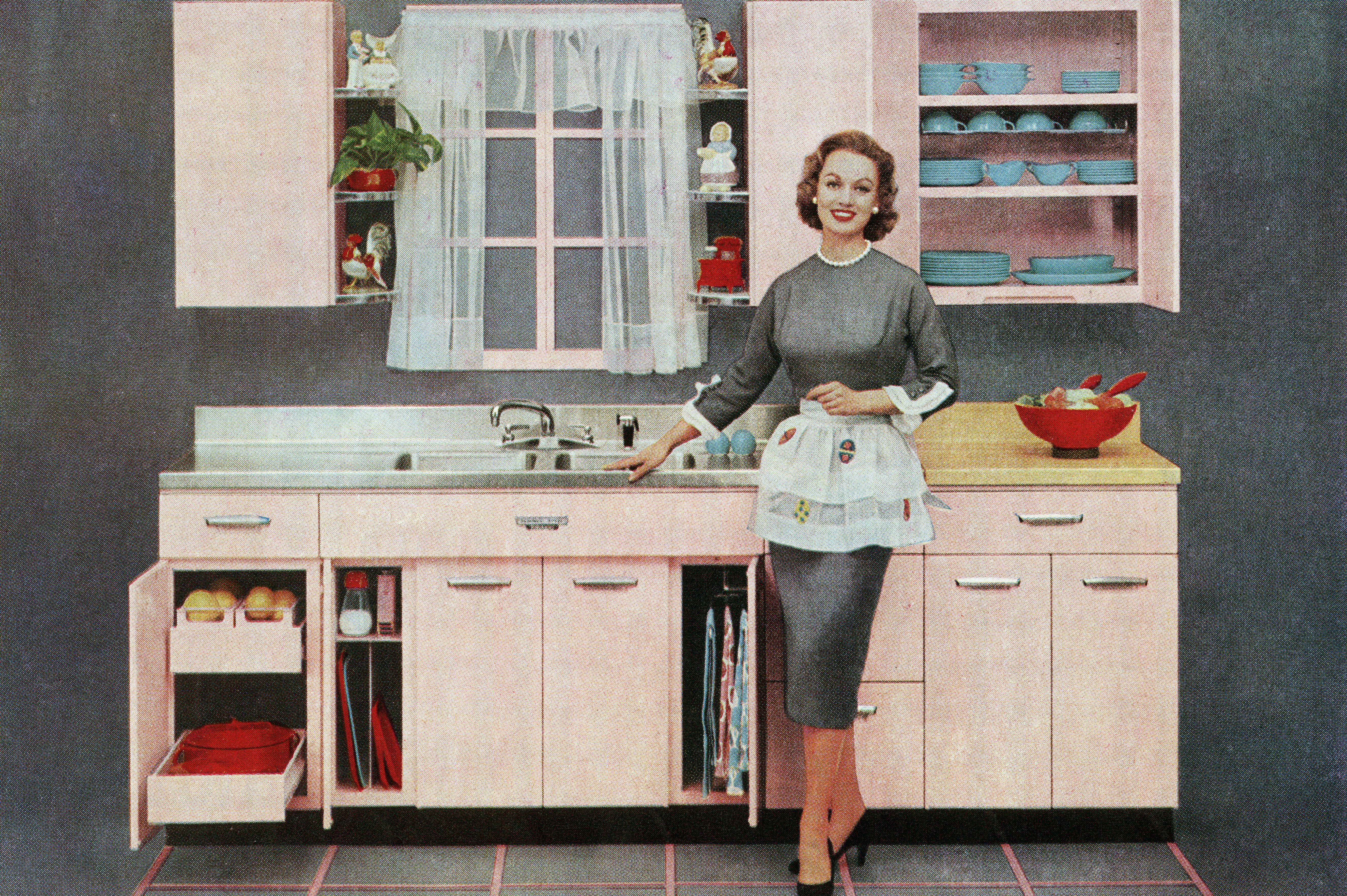 Vintage illustration of a fashionable housewife standing in front of her new pink kitchen, 1957