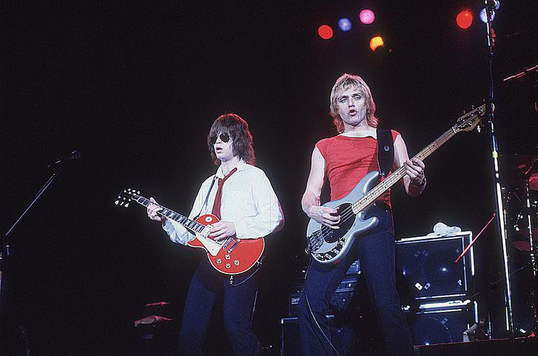 American rock guitarist Elliot Easton (left) and bassist Benjamin Orr performing on stage with the group the Cars.