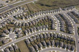 Aerial View of Suburban Homes in Texas, outline of streets and cul-de-sacs, identical lot sizes