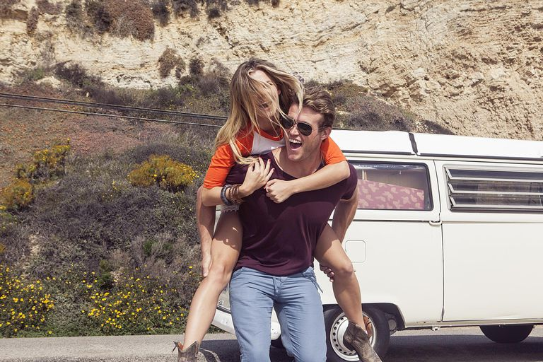 Couple enjoying camper van vacation