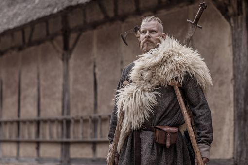 Bearded Viking Warrior Chief Male near farmhouse surroundings