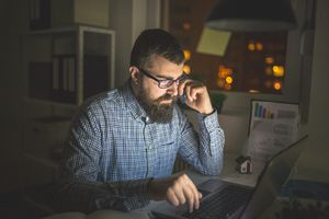 man coding late