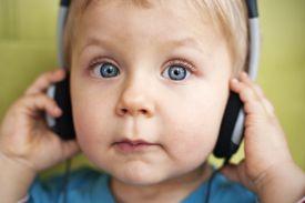 A baby wearing headphones