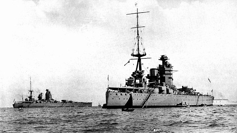 Battleships HMS Nelson and HMS Rodney at anchor.