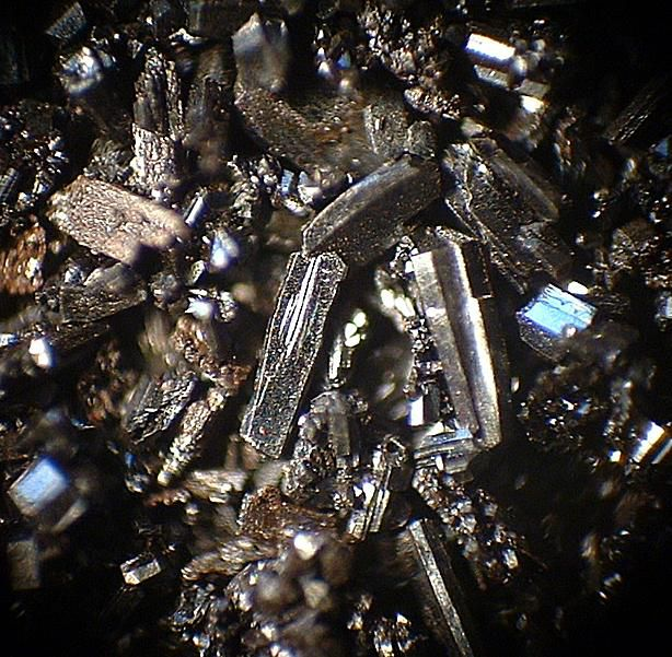 These are fullerene crystals of carbon. Each crystal unit consists of 60 carbon atoms.